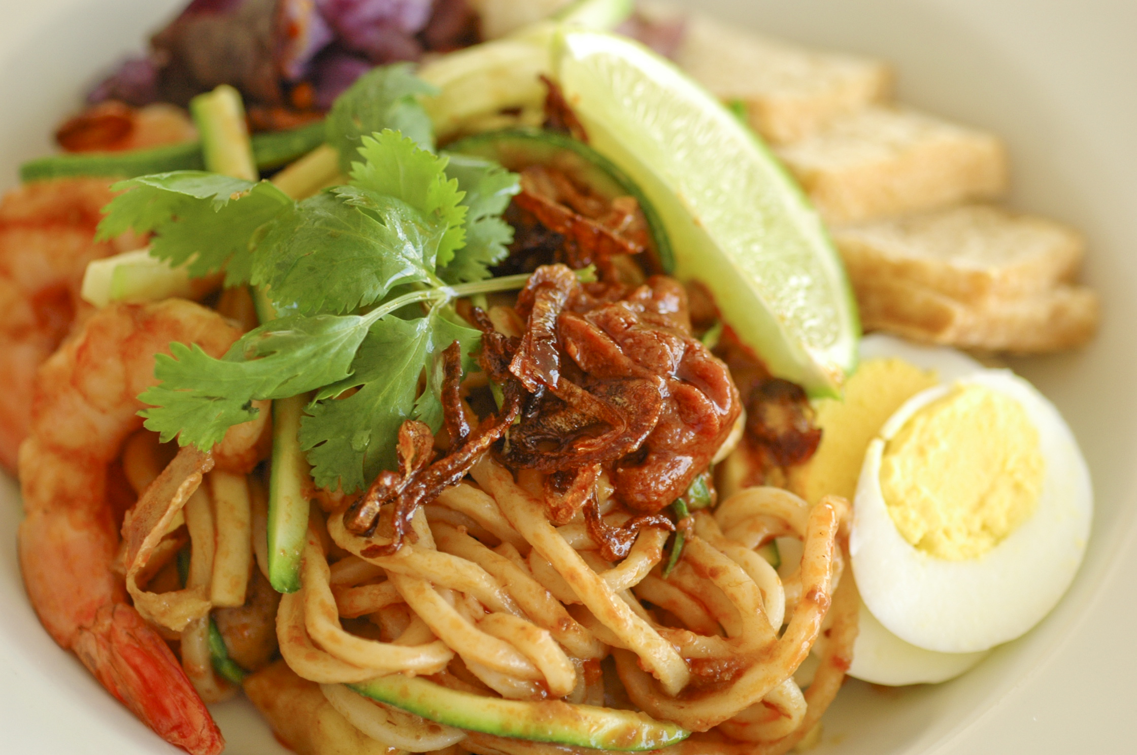 "Mee Rebus is a ""mamak"" Malay-Indian street food. The noodles are ..."